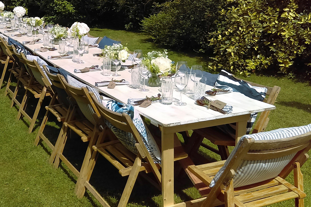 Table and chairs dressed for a wedding