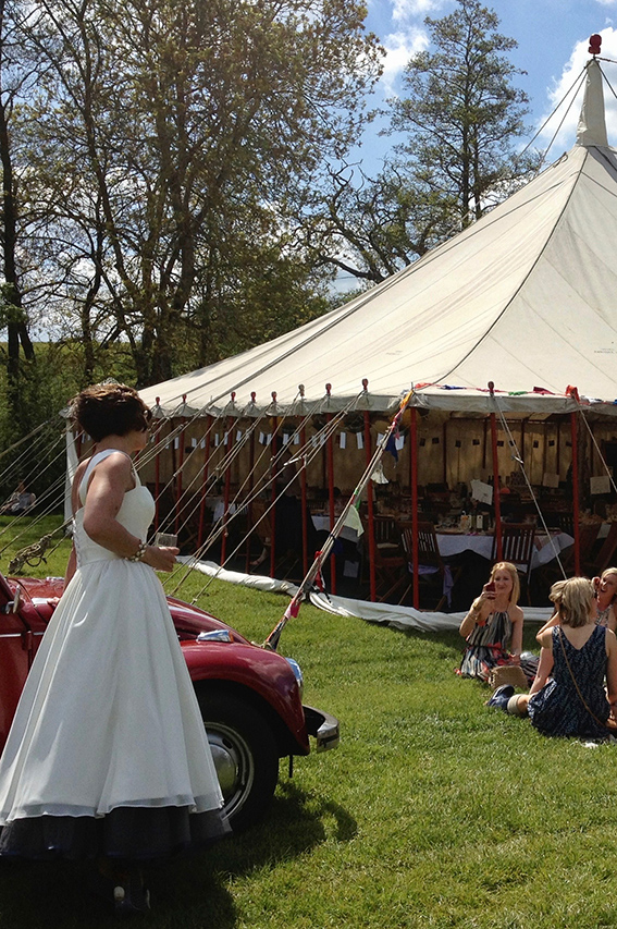 Bride and guests outside one of our marquees