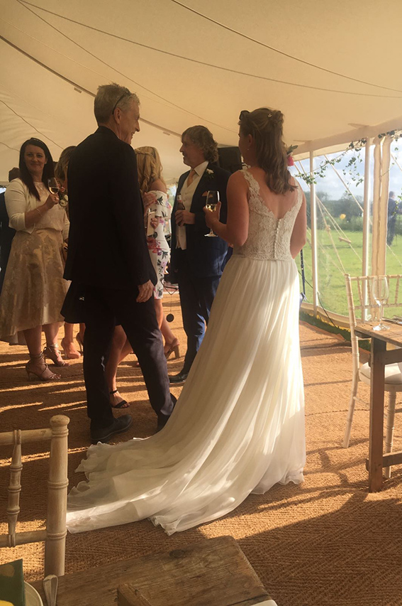 Wedding guests inside a marquee